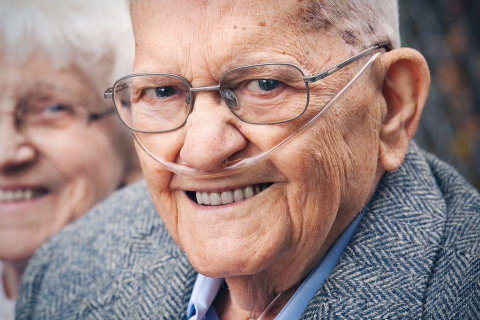 Smiling Senior Man Wearing Oxygen Tube