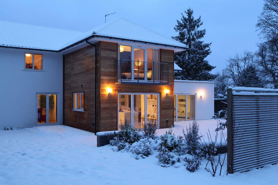 Illuminated family home in snow