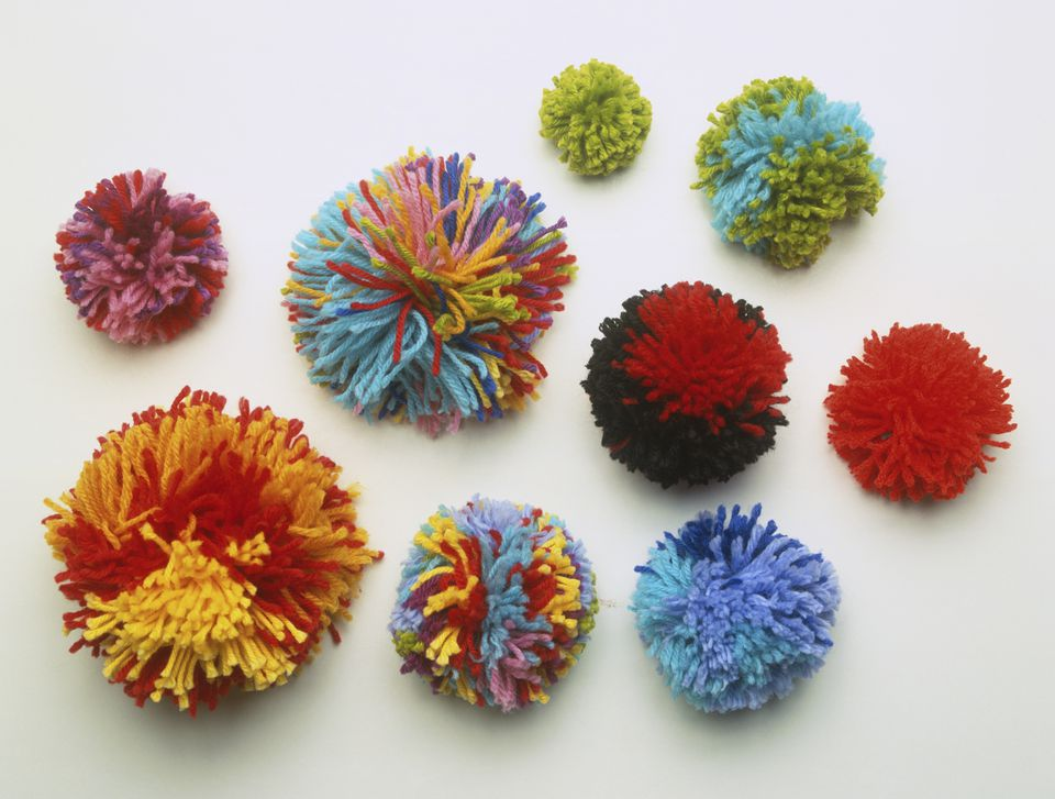Selection of colourful wool pom poms.