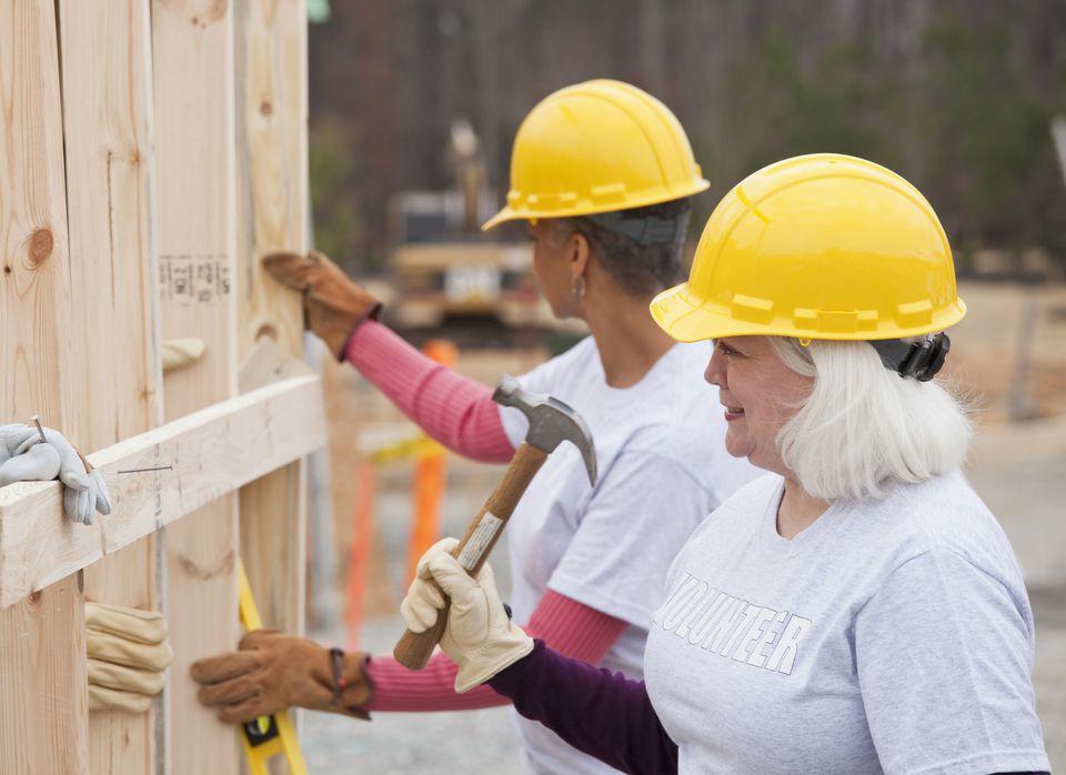 Volunteers working on Habitat for Humanity construction site