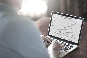Man looking at retirement plan on laptop