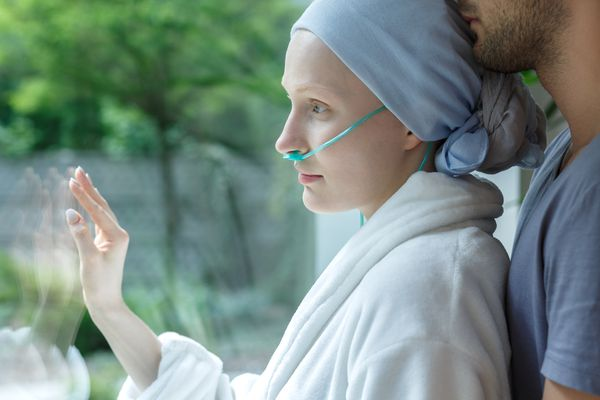 woman with breast cancer with one of the potential treatment complications
