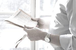 Man reading financial news