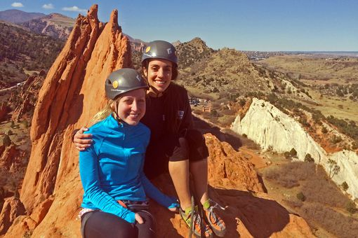 Katie and Lauren sit on the airy summit of South Gateway Rock at the Garden of the Gods, Colorado.
