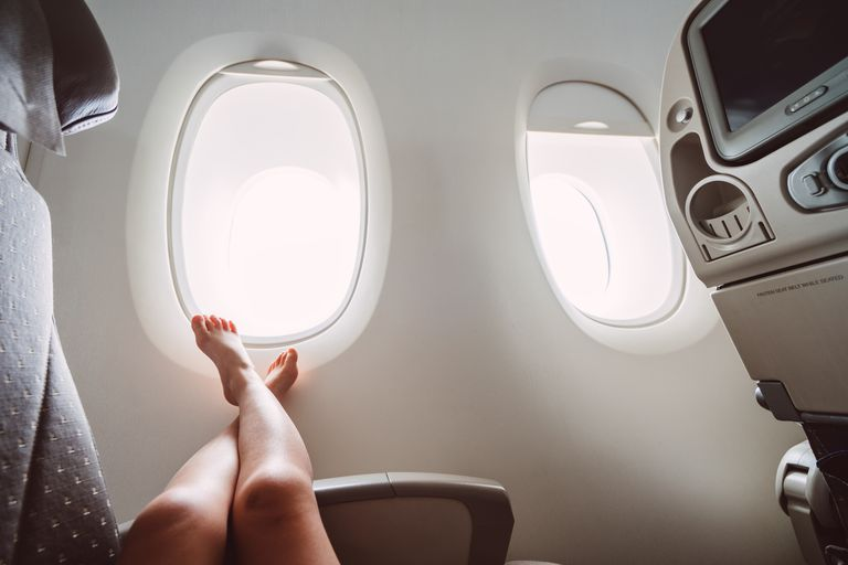 Woman resting on a plane