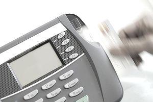 Woman swiping credit card