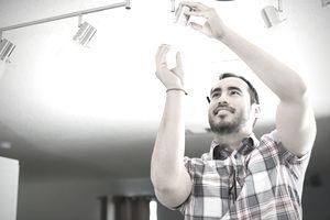 Man fixing light fixture