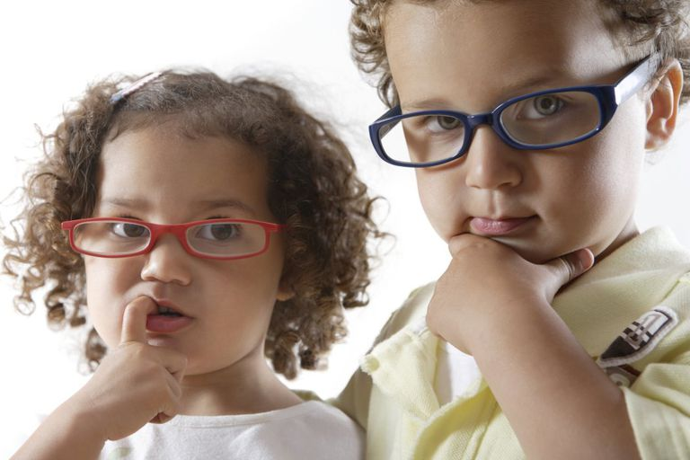 Little Boy and Little Girl Wearing Glasses, Thinking
