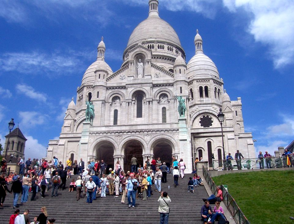 The Sacré Coeur in Paris crowns the steep heights of Montmartre.