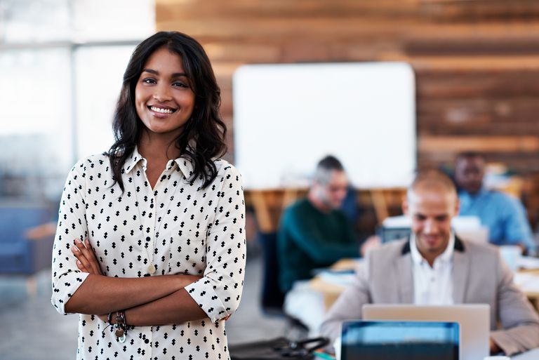 wo smiling woman in an office