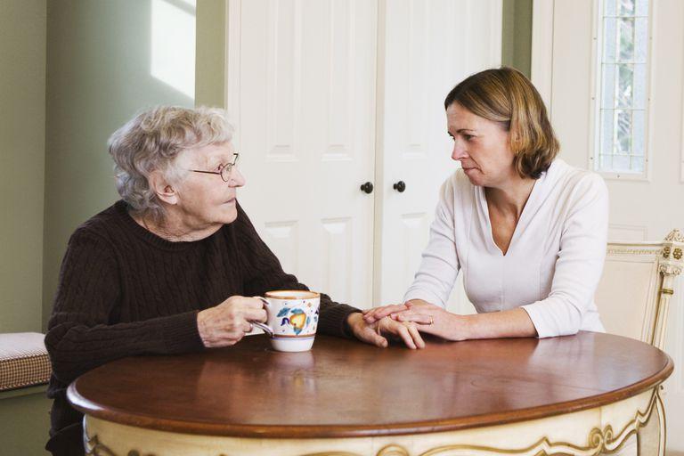 Daughter talking with Elderly mother in kitchen