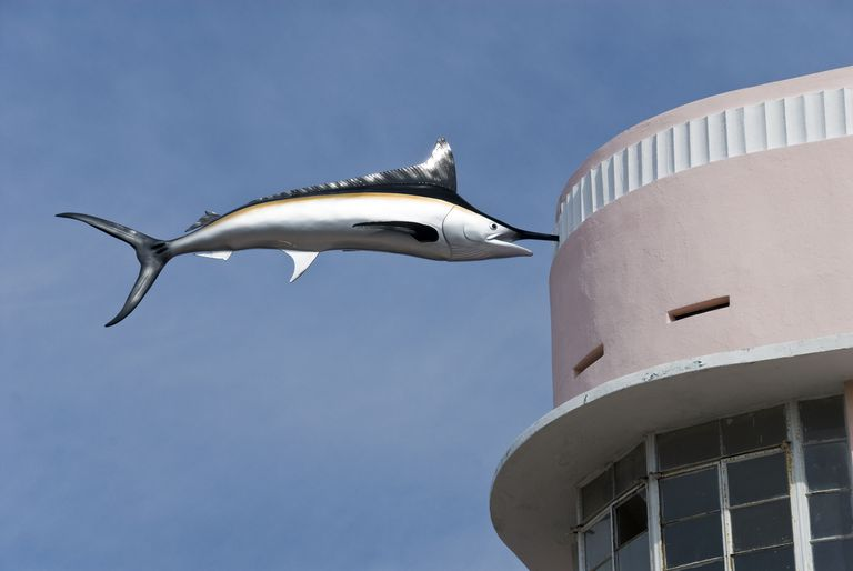 Swordfish stuck in the Art Deco facade of building in South Beach, Miami Beach, Florida