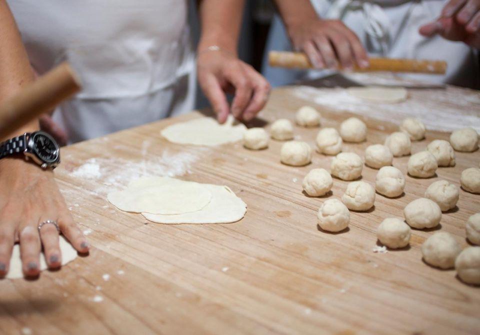 Rolling out dough for empanadas