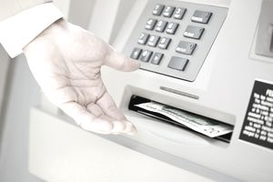 Man taking money out of ATM