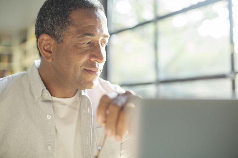 Close up of senior man at laptop