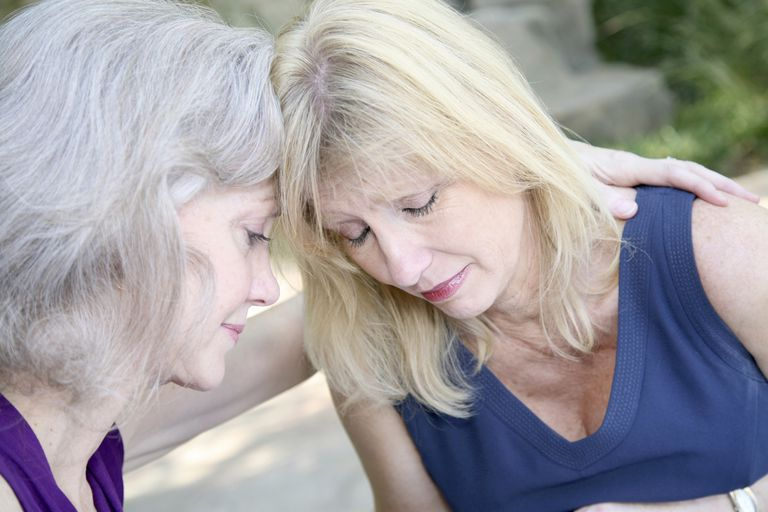Two Female Friends Praying With One Another