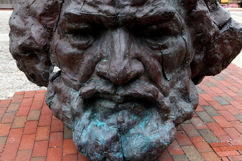 A Frederick Douglass sculpture sits outside the Frederick Douglass and Isaac Myers Maritime Park Museum