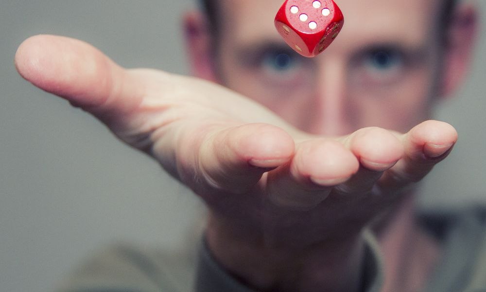 Man rolling dice.