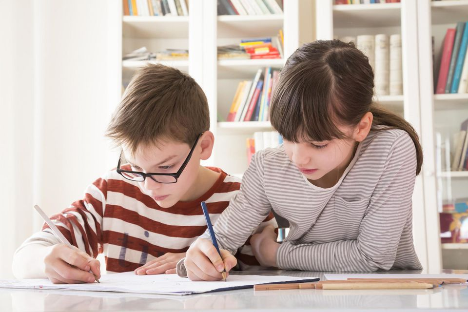A picture of children writing a list
