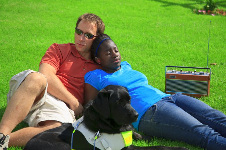 Deaf and blind couple with a service dog.