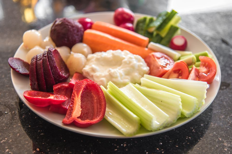 Fresh Vegetables on a white plate with Cream Cheese Dip