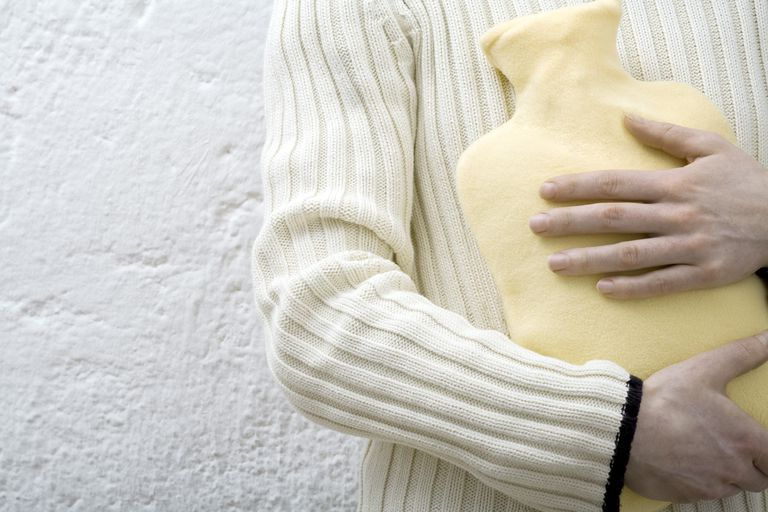 man with hot water bottle