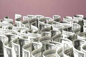 Sea of US 1 dollar bills on red