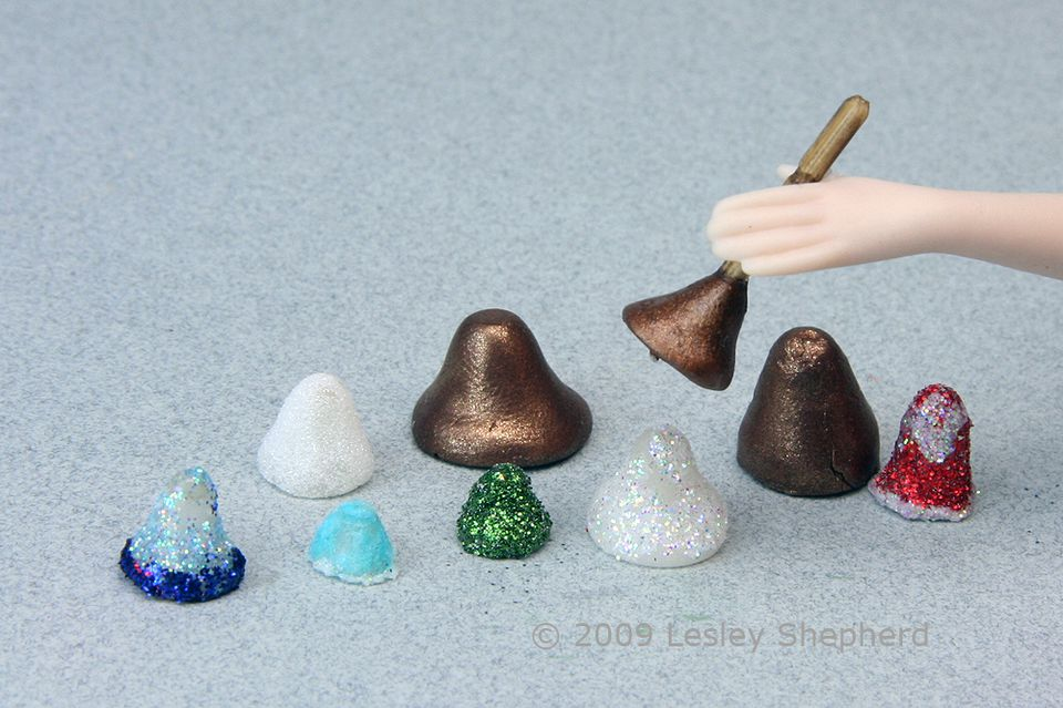 Assortment of dolls house bells in various scales made from polymer clay.