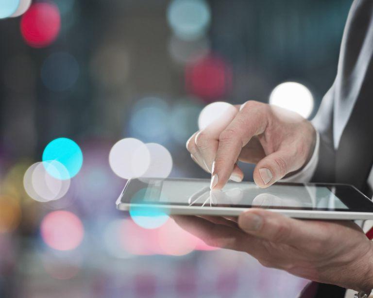 Businessman using digital tablet, close up