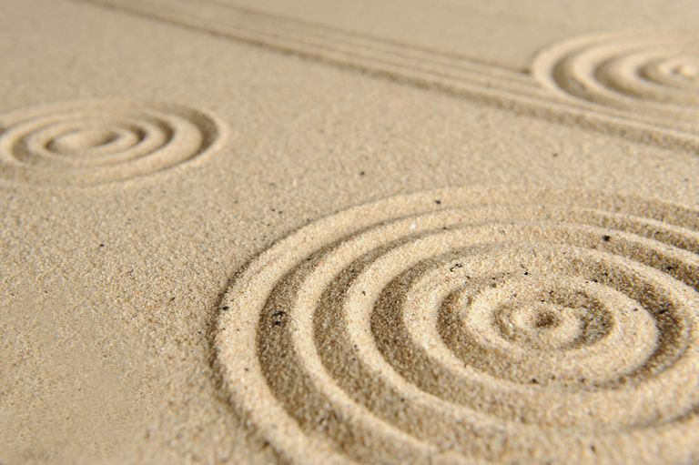 Patterns drawn in sand