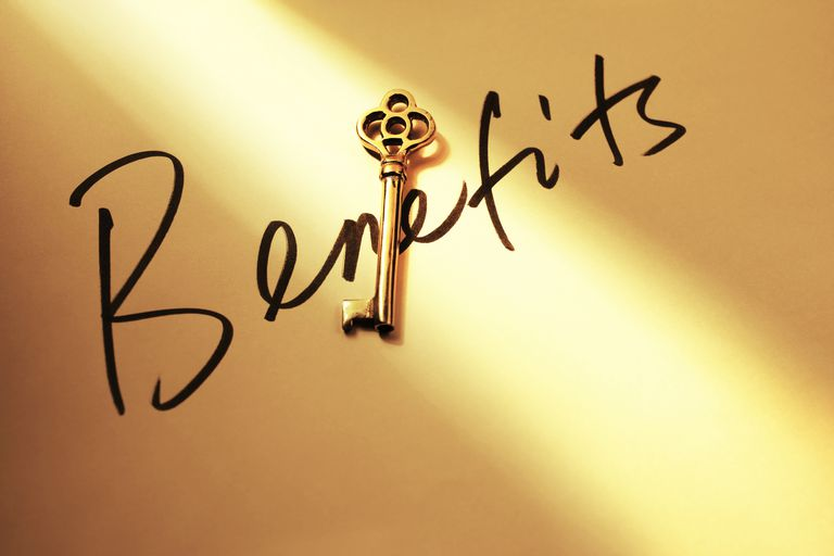 Light shining on skeleton key and handwritten word 'Benefits'.