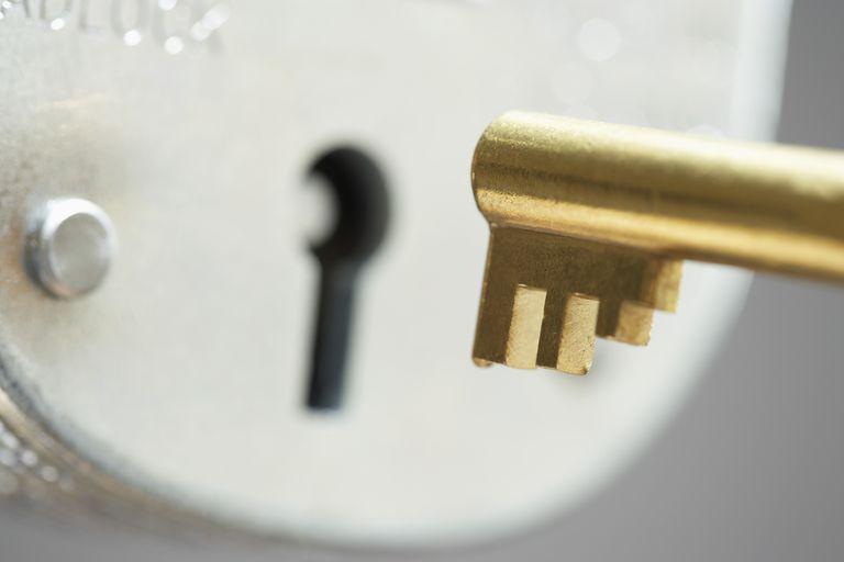 Golden key and padlock close-up selective focus