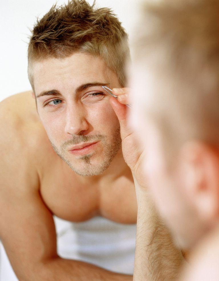 Man tweezing eyebrows, manscaping tips