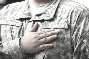 Hispanic soldier saying pledge of allegiance
