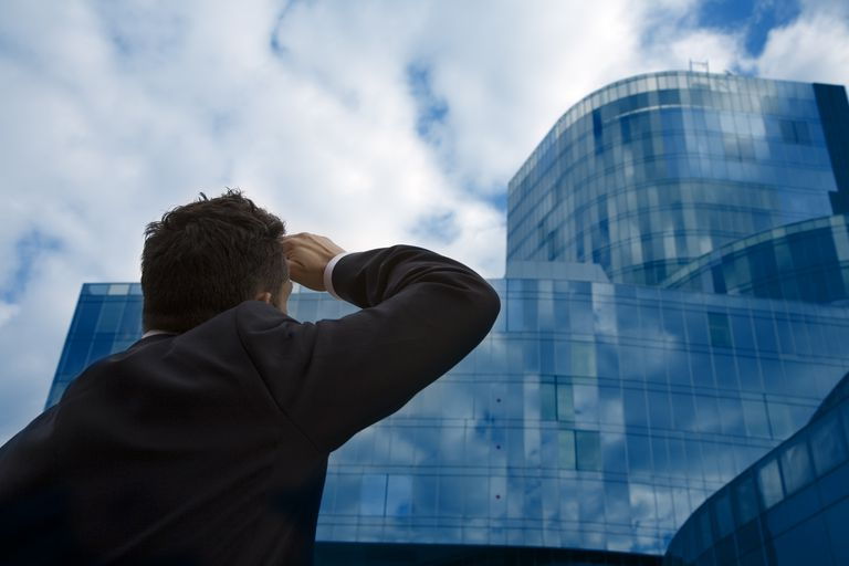 Businessman looking at a modern building