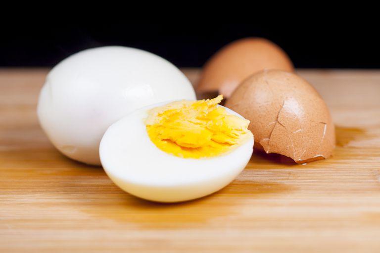 Hard-boiled egg on wood