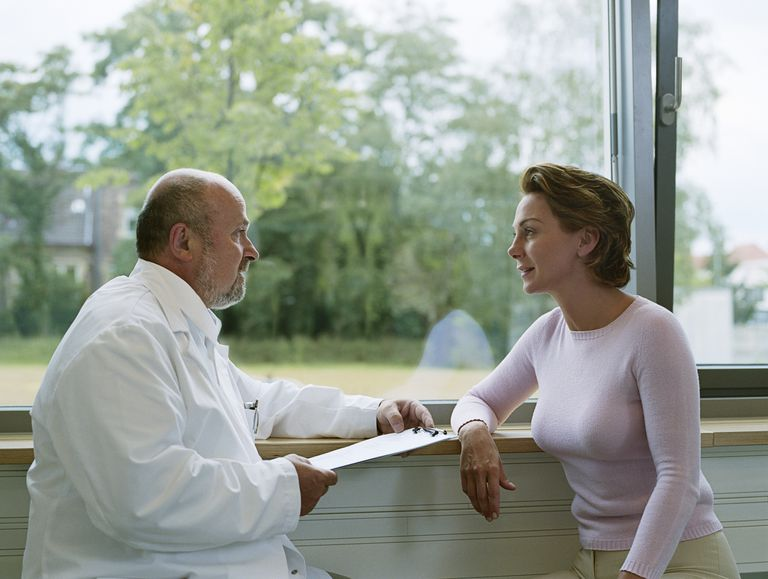 woman with celiac disease talking to doctor