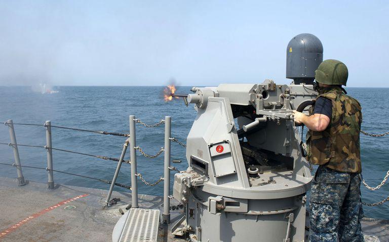 Gunner's Mate fires a 25mm chain gun aboard USS Cape St. George.