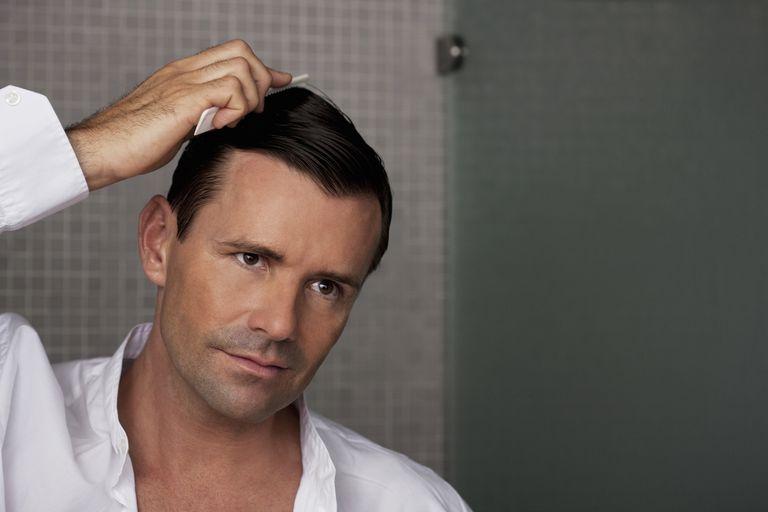 Man combing his hair in bathroom