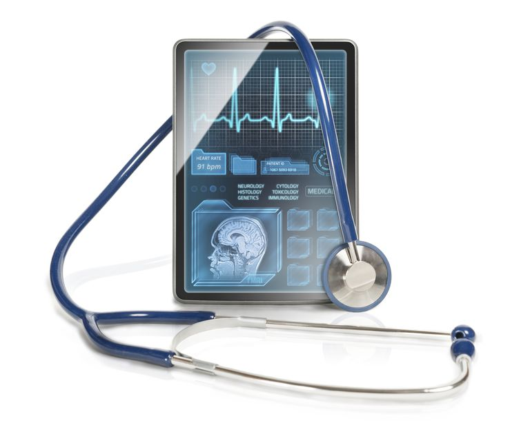 stethoscope draped over Ipad with figures