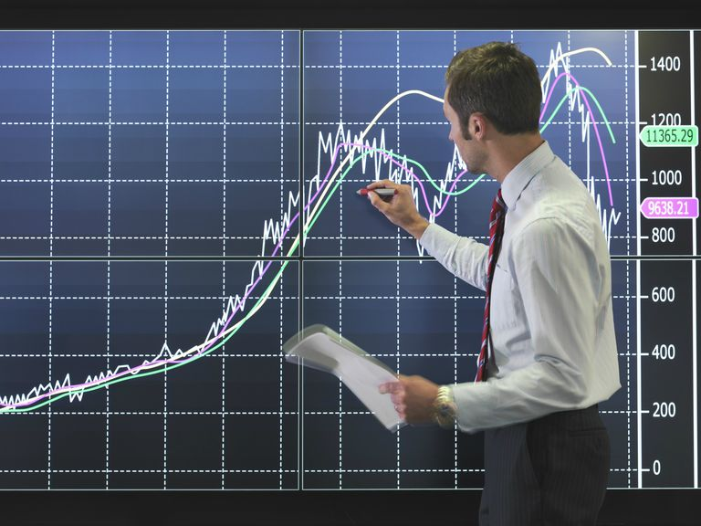 Businessman with graph on screen