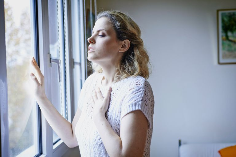 woman having trouble catching her breath