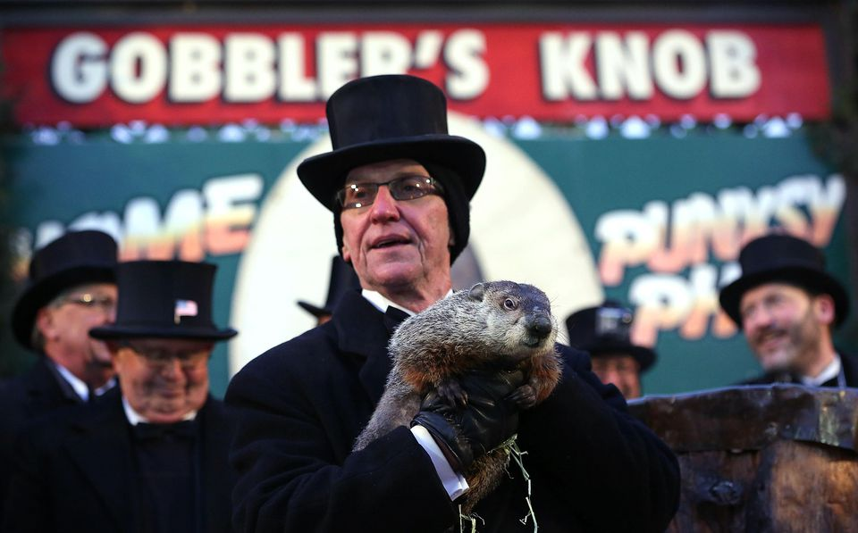 Groundhog co-handler Ron Ploucha holds Punxsutawney Phil after Phil didn't see his shadow and predicting an early spring during the 127th Groundhog Day Celebration at Gobbler's Knob on February 2, 2013 in Punxsutawney, Pennsylvania. The Punxsutawney 'Inner Circle' claimed that there were about 35,000 people gathered at the event to watch Phil's annual forecast.