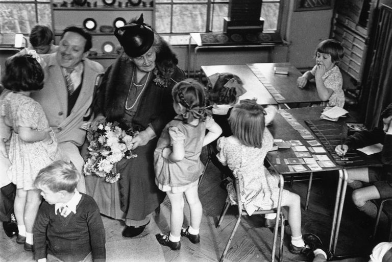 Maria Montessori with a group of children, 1946