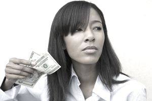 African American woman holding US currency