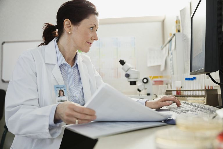 Mature female doctor reading medical files