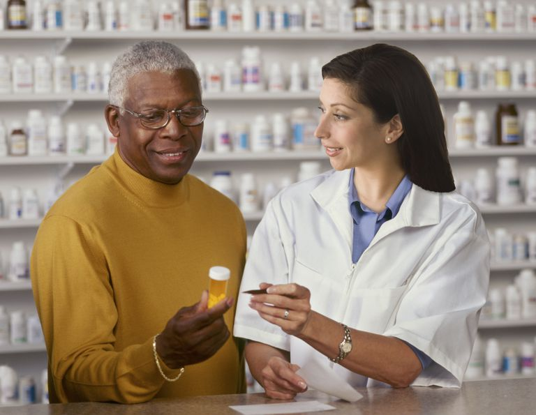 Man talking to pharmacist.