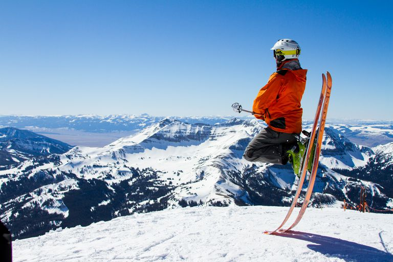 Perched atop skis