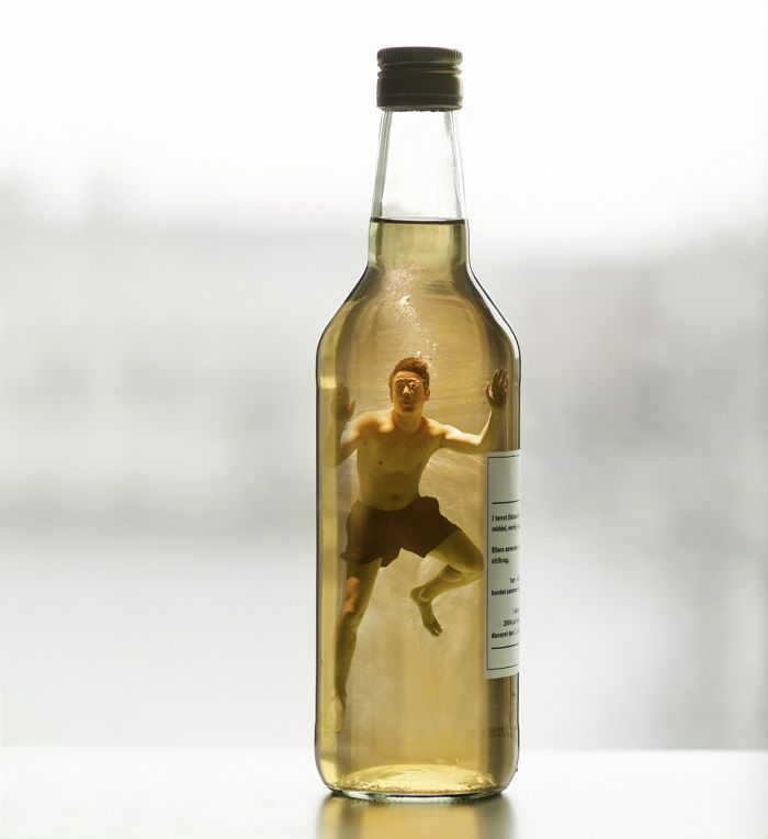alcohol addiction man in bottle