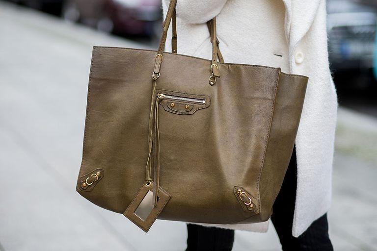 Fashion Blogger Caroline Daur, handbag detail, is wearing Balenciaga bag, St. Emilie pants and a ASOS coat on November 23, 2015 in Berlin, Germany.